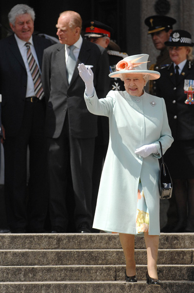 Queen Elizabeth II waves to the crowds as she leaves the National Museum of Wales in Cardiff, 2007