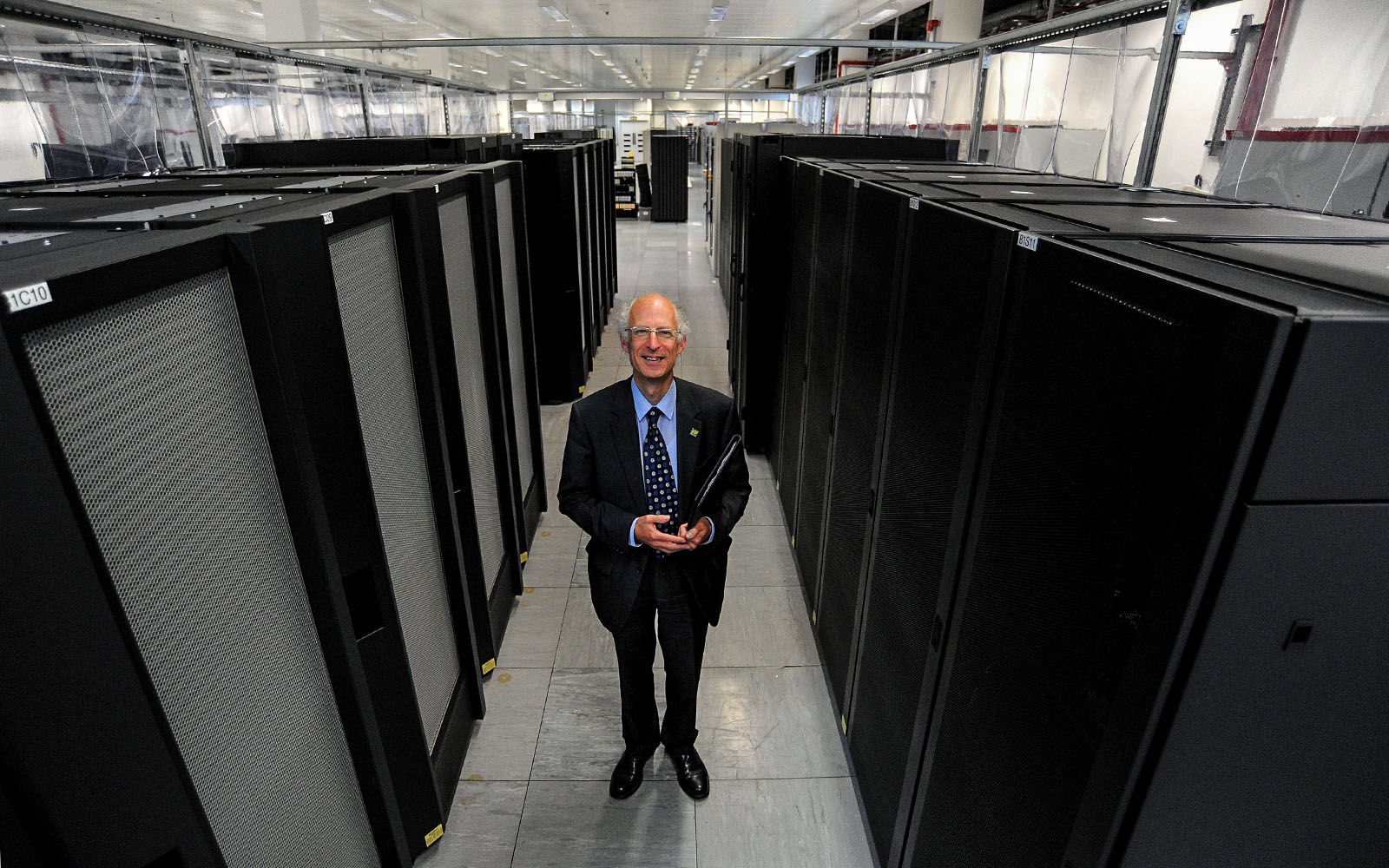 Prof. Brian Golding - Deputy Director of Weather Science at the Met Office, with the IBM P6 supercomputer