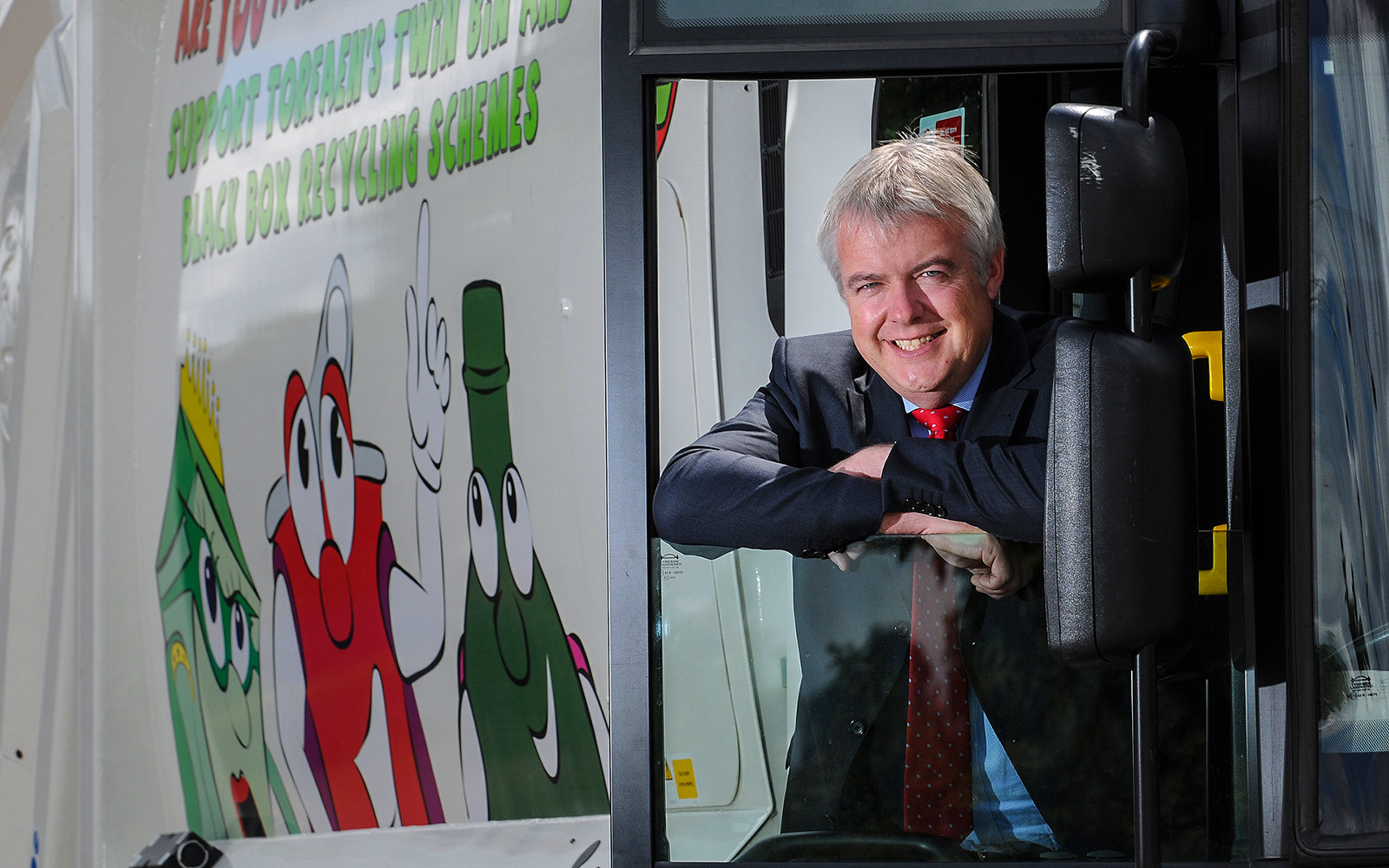 Wales First Minister Carwyn Jones travels by dustbin lorry as part of his tour of public services in Wales for Torfaen County Council
